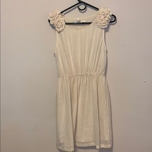 Cream/sheer dress w flower decor at both shoulders
